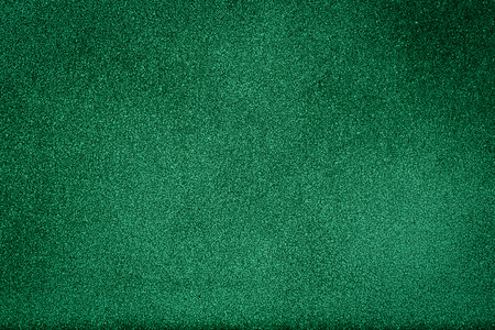 bright center: Green texture background with bright center spotlight