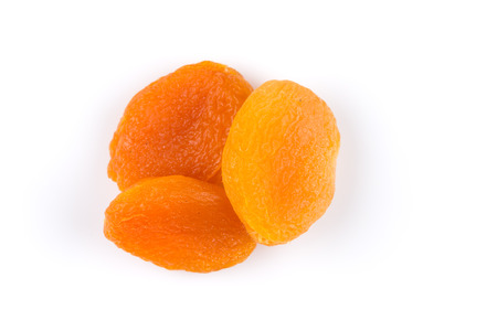 apricots: Dried apricots on white background with a light shadow Stock Photo