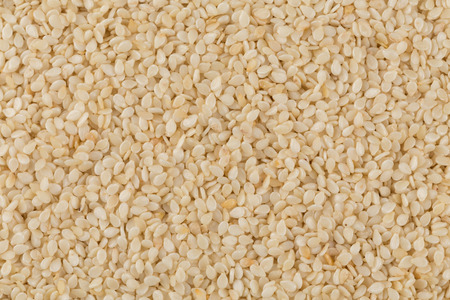 sesame seeds: Closeup of lots of sesame seeds for background Stock Photo