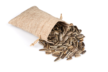 sunflower seeds in hessian sack isolated on white background
