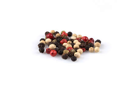 seeds of various: heap of various pepper peppercorns seeds mix on white