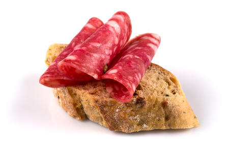 Salami on ciabatta. Sandwich of salami slices on whole grain bread. Stock Photo