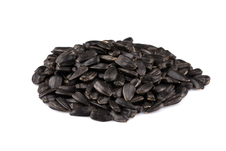 semen: Heap of black sunflower seeds isolated on a white background