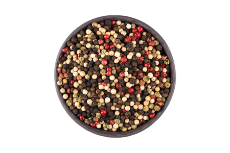 seeds of various: bowl of various pepper peppercorns seeds mix on white