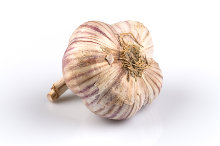 spiciness: Garlic bulb closeup isolated on white background Stock Photo