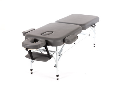 loveliness: massage bed table on the white background