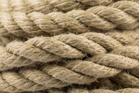 convoluted: Close-up of an old frayed boat rope as a background Stock Photo