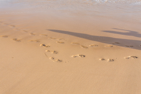 impermanent: Small and large footprints in the sand