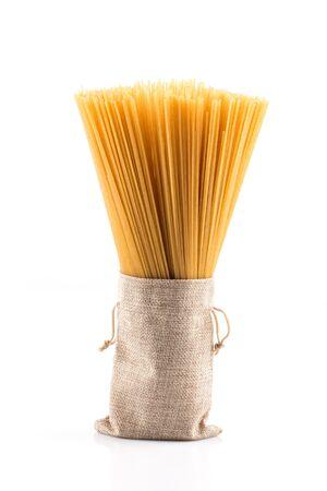 Organic whole wheat spaghetti pasta on white background Stock Photo
