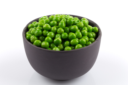 Bowl of green wet pea isolated on white background