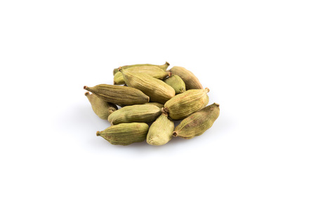 Heap of cardamom pods isolated on a white background Stock Photo