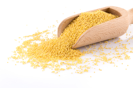 Dry millet isolated on white. Top view or flat lay. Healthy food and diet concept