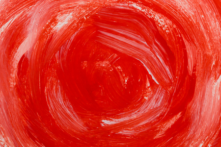 Red color paint brush strokes on the paper texture background
