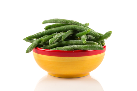 long bean: Frozen cut green beans vegetable in a bowl, isolated on white
