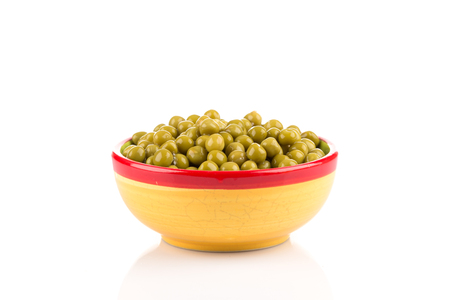 Marinated green peas in bowl isolated on white background
