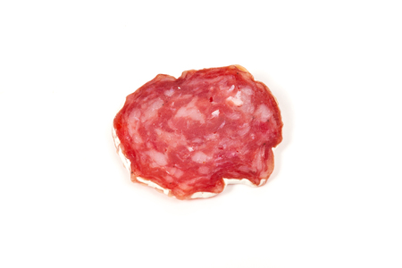 pile of red salami, isolated on a white background