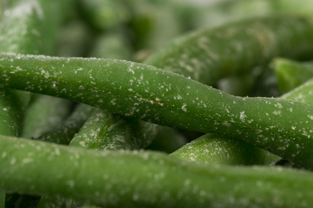 Frozen cut green beans vegetable, closeup for background