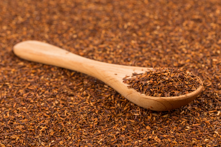 rooibos: Heap of red dry rooibos healthy traditional organic tea in spoon