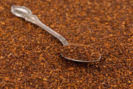 rooibos: Dry rooibos healthy traditional organic tea close up in spoon