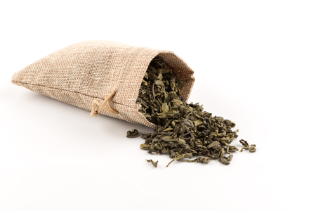 Gunpowder green tea in hessian sack closeup photo for background Stock Photo