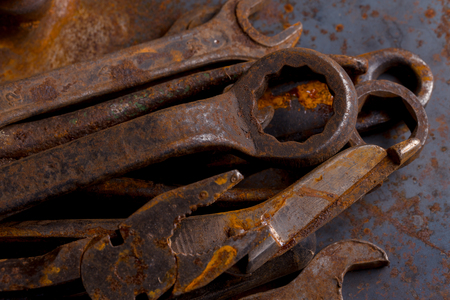 Dirty set of hand old rusty tools. Equipment for locksmith and metalworking shop