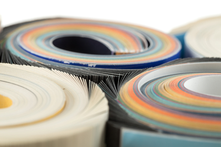 Colorful magazines close up photo - rolled up composition