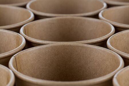 Empty disposable paper coffee cups for background