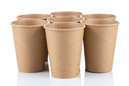 Empty disposable paper coffee cups isolated on white background