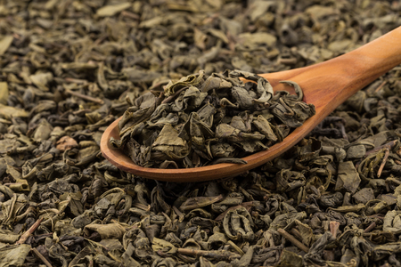 Gunpowder green tea in spoon closeup photo for background Stock Photo