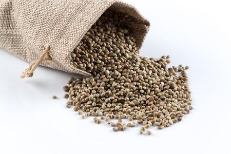 Cannabis Hemp seeds in hessian sackl close up macro shot isolated on white background
