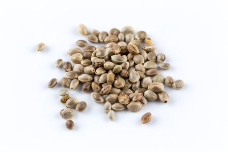 Cannabis Hemp seeds close up macro shot isolated on white background Stock Photo