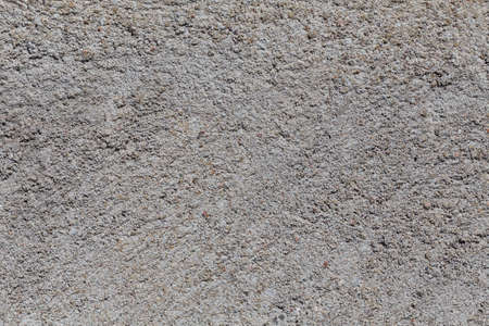 Crushed granite stones wall - close up background