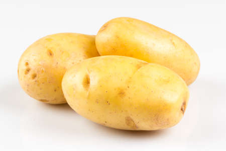New potato isolated on white background close up Standard-Bild