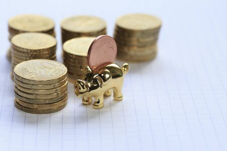 cents: A piggy bank and euro cents
