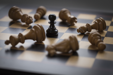 strategic focus: a chess game with board and pieces Stock Photo