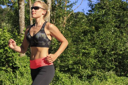 A blonde woman in workout