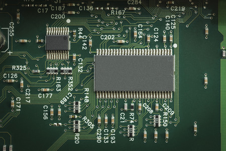 computer transistors: a chip close up on a computer motherboard Stock Photo