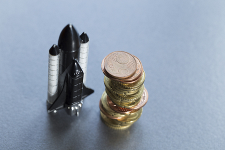 aerospace: symbolically, the cost of the aerospace program. Euro coins and rocket Stock Photo