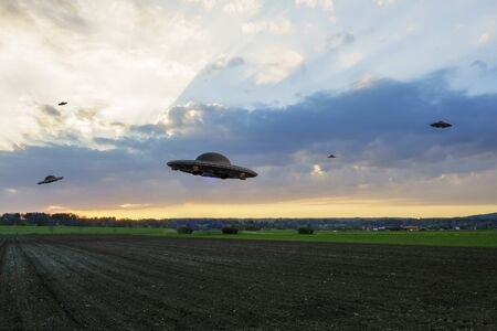 Unidentified flying objects infiltrate the earth Stock Photo