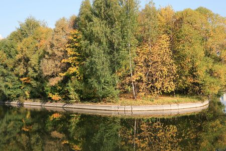pond at autumn in city park, spetember photo