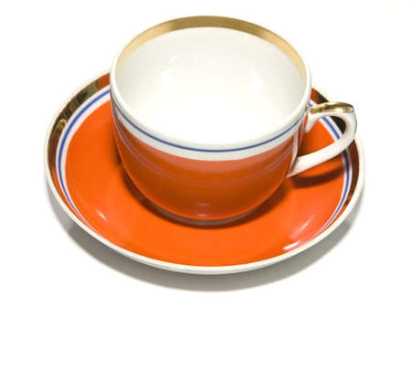 red cup with saucer on white background photo