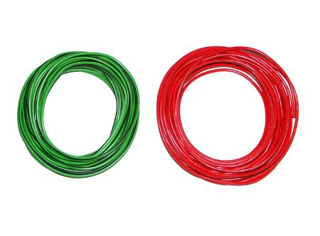 coil of wire red and green on white background photo