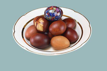 Easter egg on white plate photo