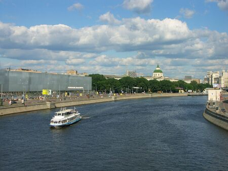 quay on river  in city center at summer photo