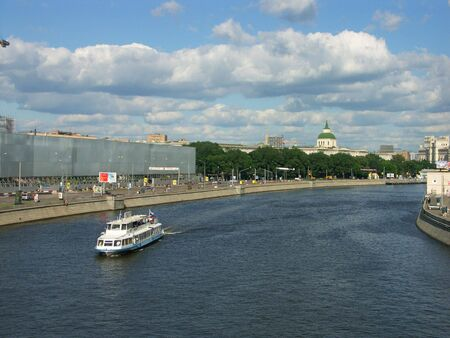 boat on river in city center photo