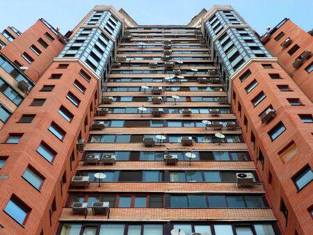brick penthouse in blue sky background photo
