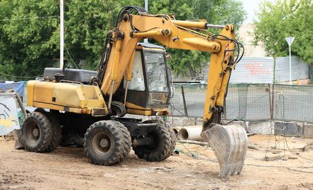 wheeled: wheeled excavator on ground at day