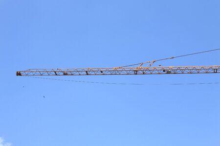boom of crane tower on sky photo