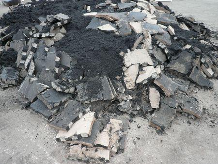 ruberoid: heap of asphalt in road repair