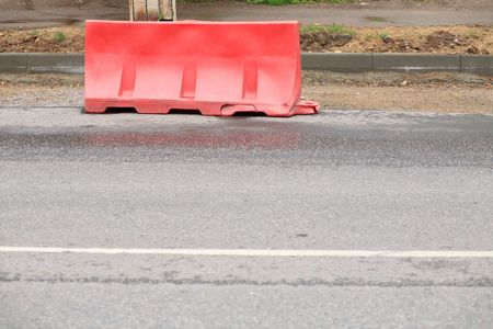 restrictive block on road at day photo